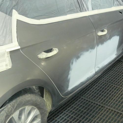Buiting Motors - Spuitwerk Wagen